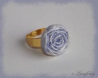 Adjustable ring shaped earthenware blue flower shape