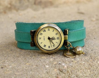 Leather shows on blue/green leather strap handmade vintage patina