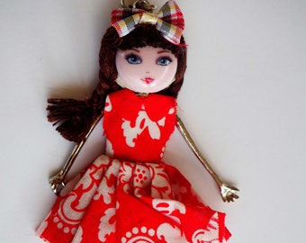 Doll pendant 12 cm, metal, red fabric, resin bag charm, pendant