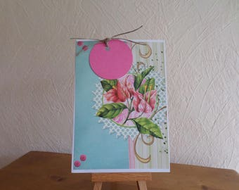 pink card featuring collage papers and tag