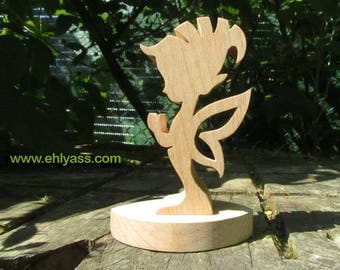Solid wood winged Elf on fretwork stand sculpture