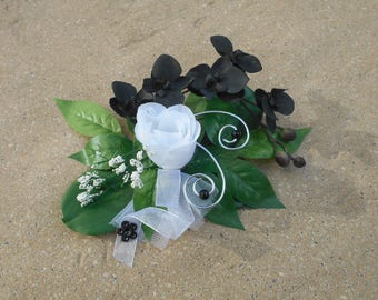 Center table - black and white and silver - artificial flowers