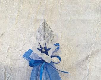 Buttonhole wedding brooch or clip has white hair / royal blue