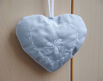 Embroidered gray fabric hanging heart