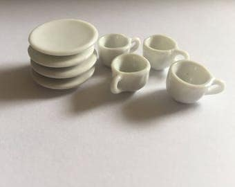 Porcelain cups and plates set