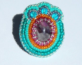 Embroidery of pearls and Amethyst ring