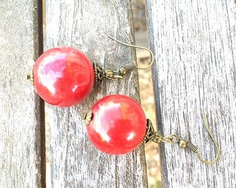 earring with 22 mm red ceramic bead, brass hook