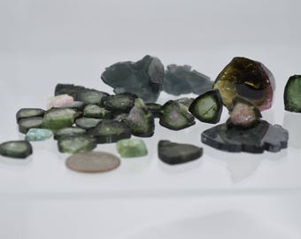 44.7g or over 222ct total weight Green Tourmaline polished slices
