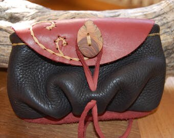 small black and red leather pouch