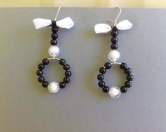 Earrings, rings of black & white pearls