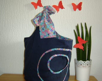 Navy blue bag with strap to tie with flowers