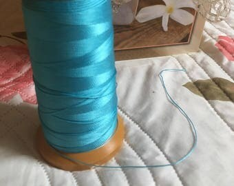 Yarn or light blue macrame cord. 0.5 mm.