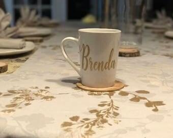 Personalized coffee mugs.