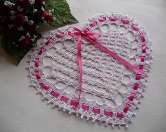 Doily shaped heart is hand crocheted in pink blue white cotton.