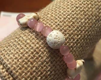 Pink essential oil lava bead bracelet with elephants