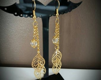 Earrings chains and golden leaves