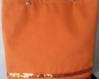 Bag has orange glitter