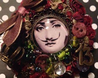 Fornasetti a mustache women brooch