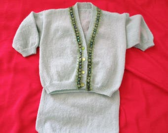 All child 3 years in green wool vest and skirt