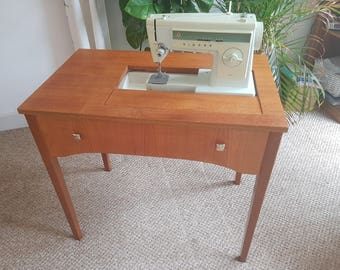 Vintage Singer sewing machine table with working machine