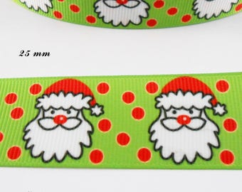 Green grosgrain with red polka dots with the head of Santa Claus in 25 mm Ribbon sold by 50 cm