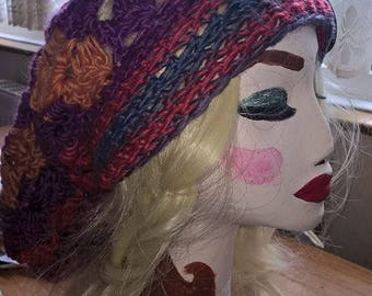 Gorgeous hand crocheted slouch hat in reds pinks and blues
