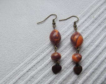 Earring marbled orange and purple with heart shaped charm