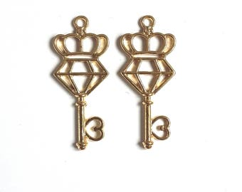 Set of 2 diamond and gold tone Crown key pendant