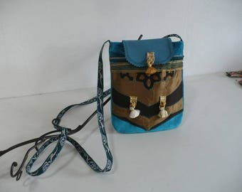 The same collection, velvet, leather and silk shoulder bag