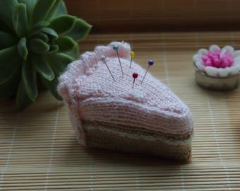 Pink knitted cake pin cushion