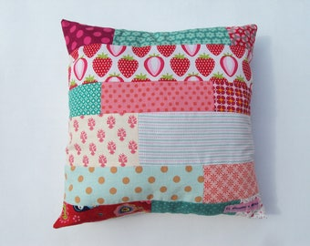 Crafted in colorful patchwork Bohemian throw pillow