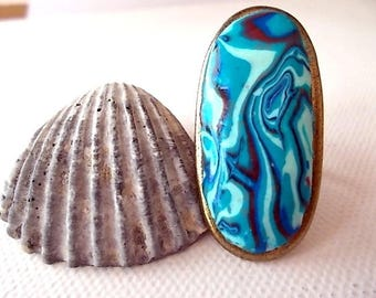 unique ring, oval, mottled dark blue, turquoise and blue light, 43mmX20mm bronze setting
