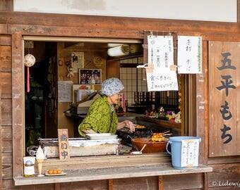 Old woman in her eetkraampje, Magome, Japan, photography
