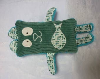 Toy with a fish appliqué