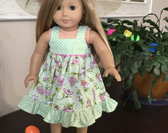 "Spring dress perfect for the Easter Parade! The dress shoes and hat are  made to fit 18"" dolls such as the American Girl.  The dress feature"