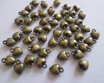 25 breloque petit coeur en métal couleur bronze 9 x 7 mm