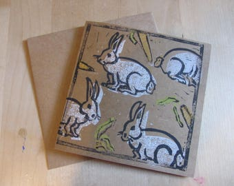 White rabbit Lino print greetings card on kraft card