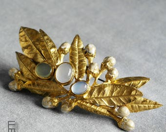 BROOCH model AZAHAR – a unique piece – brass brooch in shape of orange tree leafs and AGATE stones in different blue colours