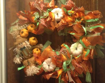Fall scarecrow and pumpkin grapevine wreath