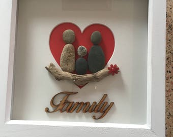 Pebble Family Picture 3 people with driftwood and red heart