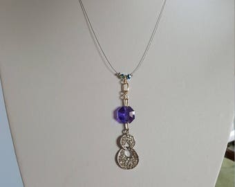 Necklace with several Swarovski Crystal with a purple Crystal elements