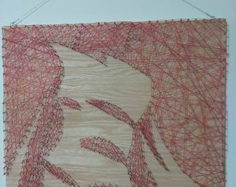 Silhouette string art on wood background