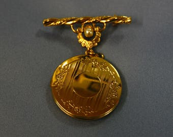 Golden brooch with locket
