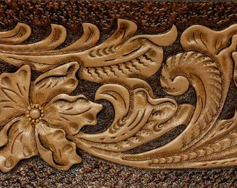 This wallet-back has been tooled in the traditional Old West Floral style.