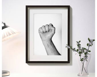 Framed photos, man's fist, furniture photos, black and white photography