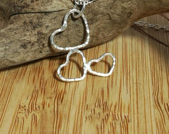 Sterling silver line hammered cascading heart necklace