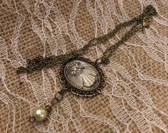 Pendant with pearl accents