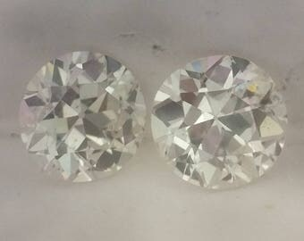 Matched Pair of European Cut Round Diamonds, .79cttw, H, SI1/2