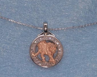 14 karat white gold diamond circle pendant with rose gold panther in the center