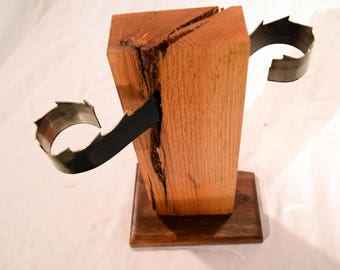 Candle holder featuring steel band saw blade, red oak and black walnut base